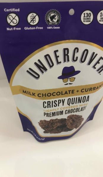 MILK CHOCOLATE + CURRANTS CRISPY QUINOA LIGHTLY COVERED WITH PREMIUM CHOCOLATE